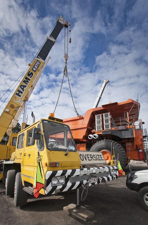 mining photography crane lifting body onto haul truck large