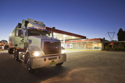 small feature image of truck at truck stop
